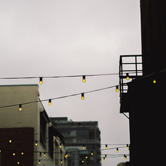 Lights On Wires (John Westrock) Tags: seattle city lights downtown pacificnorthwest pikeplace washingtonstate pnw postalley olympusomdem5 olympusmzuikoed45mmf18