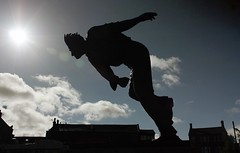 Fiery Fred (SydPix) Tags: sky sculpture black silhouette statue clouds lens yorkshire fast cricket hero fred flare legend bowler skipton cricketer trueman sewards sydyoung