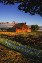 G'Morning Moulton Barn! (Geoff  RT Ficiel ) Tags: usa mountains tree water field fog clouds barn creek sunrise nikon famous foliage wyoming grandteton moultonbarn mormonbarn 35mmf2afd d700