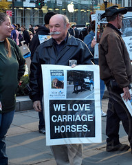 WE LOVE CARRIAGE HORSES Demonstrator, Central Park, New York City (jag9889) Tags: park city nyc people horse ny newyork animal carriage centralpark manhattan protest tourists demonstration transportation posters horsedrawn banners cp ban centralparksouth trade grandarmyplaza inhumane cruel nycparks 2013 jag9889 banhorsedrawncarriages s667a997