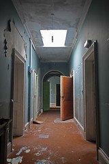 Along The Corridor (jessnphoto) Tags: old uk blue school england brown colour building green abandoned architecture canon scary doors catchycolours unitedkingdom decay interior empty corridor sigma wideangle eerie haunted hallway creepy indoors abandon urbanexploration disused inside colourful archway manor derelict abandonment decayed hallways decaying dereliction doorways ue urbex corridors sigma1020mm canon550d
