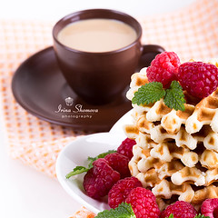 Fresh Belgian waffles with raspberries and cup of coffee on white background (Shomova) Tags: life morning red food white closeup fruit breakfast dessert golden yummy berry colorful day belgium sweet cream mint tasty plate fresh sugar gourmet delicious crispy eat snack round pastry raspberry belgian syrup taste wafer waffle stacked baked cupofcoffee valentins