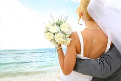 Just married couple looking towards the future (AAevent) Tags: ocean flowers wedding sea vacation panorama woman holiday man france love beach smile smiling outdoors happy groom bride back engagement holding couple honeymoon married veil dress arms joy young marriage happiness carribean husband romance lovers celebration blond future wife romantic bouquet concept cheerful joyful seaview carrying backview caucasian embracing 2530years bridaldress