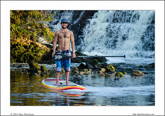 Stand up Paddler in front of waterfall (Ilan Shacham) Tags: wild man wet water sport youth river landscape fun outdoors israel boat waterfall telaviv stream surf view exercise surfer extreme young scenic dude adventure health activity float paddling sup yarkon standuppaddleboarding standuppaddleboard standuppaddling standuppaddlesurfer standuppaddler