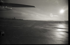Ramp in Winter 2013-2014 (maxwell1326maxen) Tags: new travel boss light bw cloud sun white black film tourism modern analog plane work airplane outside outdoors crazy lomo lomography soft open view angle united wide lofi overcast sunny f100 lo cargo arabic emirates machinery airline airbus a380 huge delivery f22 fi passenger boeing airlines selfmade ever mechanic engineer freight rolling biggest deliver loading qatar catering bulk 380 turnaround fokker 787 b787 fokker100 dreamliner homeprocessed homeprocess maxwellmaxen