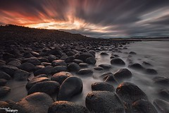Boulders (Dave Brightwell) Tags: longexposure light sunset sky seascape clouds canon reflections photography coast rocks northumberland coastal le northeast hitech eastcoast dunstanburgh bwnd davebrightwell