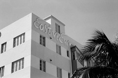 Eastview Neon Sign South Beach (Phillip Pessar) Tags: camera bw white black film beach analog 35mm store florida zoom kodak miami infinity tx south trix olympus x thrift 400 tri 70 sobe