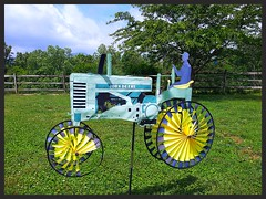 she thinks my tractors sexy (stansvisions) Tags: sky sun silly green colors grass yellow yard fence catchycolors landscape fun virginia us cool funny shiny different wind unique spin wheels lawn sparkle decorate countrymusic unexpected jobsite johndeere kennychesney windornament thelightfantastic odc fencesandfencing unlimitedphotos stansvisions