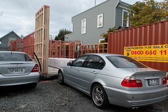 Framing Up (Jocey K) Tags: autumn trees houses newzealand christchurch sky signs cars clouds buildings construction framing buildingsite rebuild shippingcontaniers