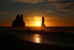 Reynisdrangar Sunrise - Half halo (Nanak26) Tags: iceland landscape reynisfjara vik sea water sky cloud wave reynisdrangar beach black rocks formation basalt waves big vulcanic vík nature coast southern travel sunrise formations halsanefhellir ocean south coastline seascape volcanic icelandic beautiful beauty natural shape rock nobody outdoors tourism landmark dramatic column coastal geology pebble nordic white outdoor plage roche soleil leverdesoleil halo golden lever roches volcaniques vague stunning víkímýrdal islande shoreline stack stacks