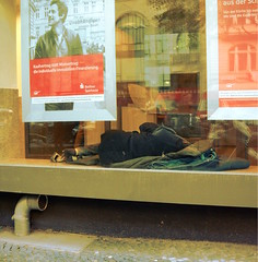 Sleeping in a bank (Krummsdorf) Tags: berlin homeless westberlin citywest