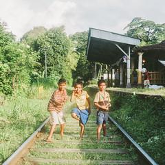 Playing On The Tracks (richardhwc) Tags: 120 6x6 film kids rolleiflex mediumformat kodak railway srilanka ceylon kandy 35e planar carlzeiss portra160 75mmf35 coatingdegraded