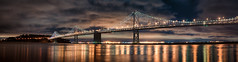 Night over the San Francisco Bay Bridge (Craig Hudson Photography) Tags: sf sanfrancisco california city bridge cali night island lights bay cloudy sanfranciscobayarea sfbayarea norcal northern yerba buena sanfranciscobaybridge sfbaybridge nightpanorama sanfranciscopanorama