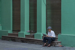 Time to read (Keith Mulcahy) Tags: city travel vacation people buildings reading newspaper holidays sitting chaos oldman vietnam busy hanoi crowds oldquarter canon2470mmf28 canon5dmk3 september2013 keithmulcahy blackcygnusphotography ppa7a0 ppd56c