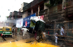 City on a rainy day (Tapas Biswas) Tags: life road street morning travel people india abstract color colour rain umbrella season outdoors nikon day rainyday image artistic market candid indian creative culture streetphotography vivid streetlife vendor indianmarket hindu kolkata bengal rainyseason bengali artisticphotography westbengal candidphotography d90 indianculture nikond90 onlyindian nikod90 nikond9o