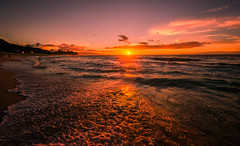 Sunset at Oahu Hawaii (Riddhish Chakraborty) Tags: sunset vacation seascape color beach nature weather silhouette horizontal relax landscape screensaver background hawaiian tone foreground sandybeach sunsetbeachpark oahusunset northshoreofoahu goldenhr wwwrcdigitalphotographyzenfoliocom
