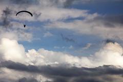 Paraglider (CoolMcFlash) Tags: sky silhouette sport clouds canon person photography eos austria tirol österreich day fotografie wind cloudy extreme himmel wolken windy gliding paraglider tamron tyrol umris bewölkt windig kontur 18270 extremsport 60d b008 gleiten