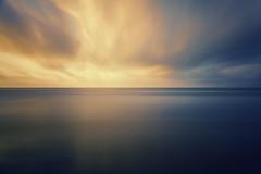 Morning Glory (Mabry Campbell) Tags: longexposure morning blue sea orange usa seascape reflection beach gulfofmexico water june clouds sunrise photography dawn coast us photo texas photographer gulf unitedstates image fav50 horizon unitedstatesofamerica fav2