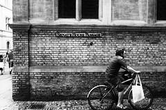 L1000436-Edit.jpg (Luminor) Tags: uk cambridge england people man heritage bicycle town blackwhite university candid transportation gb nik fx peoplewatching streetphotgraphy leicaphotography apsc silverfx xvario