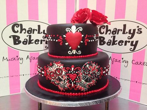 2-tier black fondant wedding cake decorated in Dia de los Muertos ...