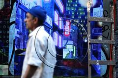 Man passes in front of a street  colorful graffiti.Greece (aggelikikoronaiou) Tags: life street blue urban man color wall walking poster graffiti outdoor painted streetlife pedestrian athens greece walker passage society socialdocumentary reportage urbanlife urbanphotography passingby streetwall citydowntown socialreportage greekcrisis