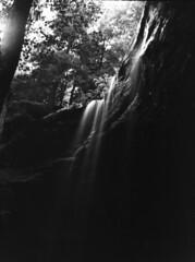 Falling into the Dark. (Grey Haze) Tags: camera blackandwhite usa film dark paper waterfall view eastern ilford 5x7 fibre korona ilfordfp4 blackandwhitefilm ufg gundlach ethol gundlachkorona etholufg