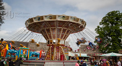 Carousel at the Castle (Nigel Jones LRPS) Tags: fun ride fairground carousel fair colourful enjoyment exciting chairoplane