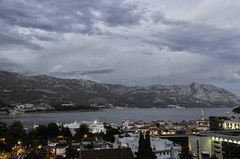 Budva (danny_ukl) Tags: city travel sea sky mountains water town nikon cloudy resort roofs adriatic montenegro budva d5100