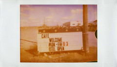 Cafe (Nick Leonard) Tags: arizona sky film sign clouds analog vintage polaroid cafe route66 open desert nick motel roadtrip days scan retro joycam signage hours welcome polaroid500 seligman expiredfilm polaroidjoycam messageboard instantfilm letterboard 500film type500 epson4490 historicroute66 polaroid500film expired2005 nickleonard believeinfilm