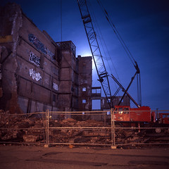 (patrickjoust) Tags: new city ri light england urban usa moon color building 120 6x6 tlr film night analog america dark square lens island us reflex focus long exposure fuji mechanical metro crane united release tripod north patrick twin slide cable providence warehouse rhodeisland chrome wharf after medium format states tungsten manual expired rhode joust e6 balanced 65 estados reversal unidos decontruction mamiyac330s autaut fujichromet64 sekor65mmf35 patrickjoust