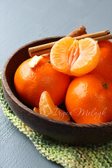 Bowl of fresh mandarins with cinnamon sticks on green knitted napkin (Iryna Melnyk) Tags: christmas winter food orange white color green nature yellow tangerine mandarine fruit ball studio season table dessert wooden juicy healthy knitting sweet eating background space group gray harvest tasty bowl fresh whole eat health snack vegetarian tropical tropic mandarin citrus oranges organic diet tradition agriculture heap copy freshness ripe nutrition refreshment vitamin vitality