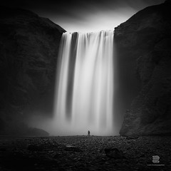 Lost Treasure (S.D.G Photographie) Tags: longexposure wild sky blackandwhite bw cloud cold fall ice nature water photoshop dark landscape photography blackwhite waterfall iceland eau skies cloudy fineart fine falls ciel filter waterfalls lee icy cascade chute bwphotography islande fineartphotography sdg skogafoss dramatique chutte leefilter leefilters skoga bigstopper sebastiendelgrosso