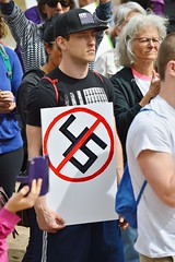 Is it the number 45 or is it a swastika on this sign held by this man at a Denver protest against President Trump's immigration policies? (desrowVISUALS.com) Tags: demonstration rally protest immigration immigrationreform swastika resisttrump immigrationprotest immigrationpolicy resist