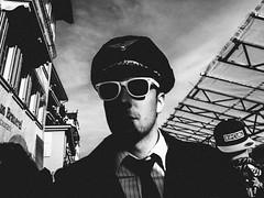 ticket for an aeroplane (matthias hämmerly) Tags: swiss switzerland street streetphotography candid grain contrast monochrom black white bw luzern ricoh grd 2 personen porträt einfarbig