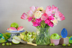 Still life colors of spring. (Phyllis Freels) Tags: apples arrangement blue bowl carnations cookies flowers fruit glass grapes green indoor knife pink stilllife tabletop tulips vase yellow