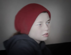 RED (Joseph Dimartino) Tags: red child children portrait fineart face girl art beautiful candid individual eyes people gaze hat hoodie introspective street streetphoto colorless nyc student truth strength music