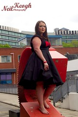 IMG_4465 (Neil Canon Keogh) Tags: red black vintage necklace highheels dress retro ring redhead bow buskers bracelet heels rockband pinup pinupgirl trianglesquare manchestercitycenter dressmodellaura