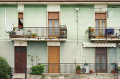 Italian popular flats (Shade-of-Light) Tags: house colour horizontal architecture outdoors photography italian view flat pastel balcony curtain entrance nobody flats hues fullframe popular residential condominio frontview residentialarea houseentrance dwelling tranquilscene ringhiera architecturalelement tendadasole buildingexterior traditionallyitalian residentialstructure typicallyitalian imagecreated21stcentury architecturalbackground suncurtain