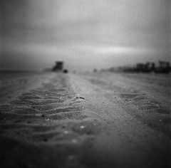(Graziella Ines) Tags: blackandwhite bw white black 6x6 film beach water analog mediumformat sand gloomy cloudy ground lifeguard analogue pushed huntingtonbeach 120mm tmax100 hasselblad501cm lifeguardstation monocchromw