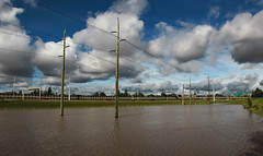 New Lakes (Calgary Flood 2013) (LostMyHeadache: Absolutely Free *) Tags: road summer sky cars nature water grass weather clouds canon highway flooding traffic flood vehicles powerlines vehicle yyc naturaldisaster davidsmith powerpoles floodwaters stateofemergency calgaryalbertacanada eos60d yycflood calgaryflood2013