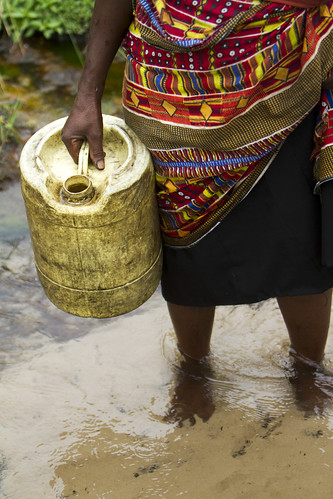 A woman drawing water from stream, Senanga, Western Zambia. Photo by Felix Clay/Duckrabbit, 2012.