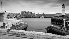 Kirkwall Harbour (MBDGE) Tags: uk longexposure light blackandwhite cloud lighthouse fish blur clouds docks canon boats scotland pier boat fishing fisherman dock orkney scenery long exposure waves ship britain ships wave nd fishingboat pilot kirkwall slipway lightroom neutraldensity northernisles 10stop canon650d