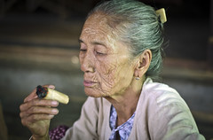 Smoking cheroot in Bagan (PawelBienkowski) Tags: burma cigar myanmar bagan cheroot myanmarwoman burmawoman