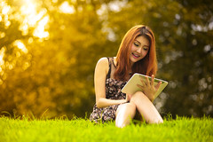 Asian woman using digital tablet in park (Patrick Foto ;)) Tags: park summer portrait people woman green nature girl beautiful smile grass smiling female digital computer notebook asian outside outdoors happy person one pc student day sitting technology adult outdoor laptop touch internet joy young lifestyle happiness device communication using attractive learning teenager wireless casual leisure tablet connection touchscreen mobility touchpad