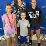 """<b>Aquatic Center Dedication of Service_100413_0230</b><br/> Photo by Zachary S. Stottler Luther College '15  Above: Christine Magnuson, two time Olympic Silver Medal winner, poses with various fans at the Luther College Service of Dedication for the new Aquatic Center.<a href=""""http://farm4.static.flickr.com/3675/10095982874_e0a954112c_o.jpg"""" title=""""High res"""">∝</a>"""