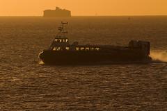 Hovercraft at Dawn (fstop186) Tags: sea orange silhouette sunrise sailing glow fort victorian spray isleofwight speeding defence goldenhour hovercraft freedom90 canonef100400mmf4556lisusm hovertravel canon7d horsesands