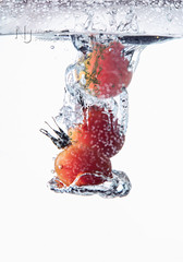 Tomato Splash (Nigel Jones LRPS) Tags: water fruit tomato freeze frame ripples splash