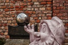 Il nano e la sfera... (CettaCaracciolo ( nei ritagli di tempo )) Tags: tetti mura nano camini particolari sfera prati morimondo abbaziadimorimondo