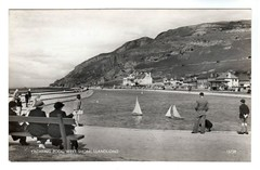 1950 Yachting Pool - Llandudno Wales (oldsailro) Tags: park old boy sea summer people sun lake playing beach water pool girl sunshine youth sailboat race vintage children fun toy boat miniature wooden pond model waves sailing ship time yacht antique group boom mast hull keel