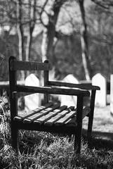Graveyard Bench (Furious Zeppelin) Tags: bw white black graveyard bench wooden nikon 80 furiouszeppelin fz